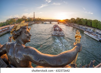 Alexandre III bridge in Paris against Eiffel Tower with boat on Seine, France