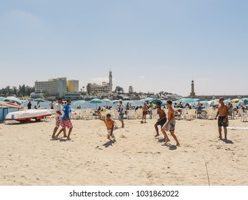 Alexandria, Egypt - 2008 - Group of young men playing beach vollyball in Al Montaza , Alexandria, Egypt.