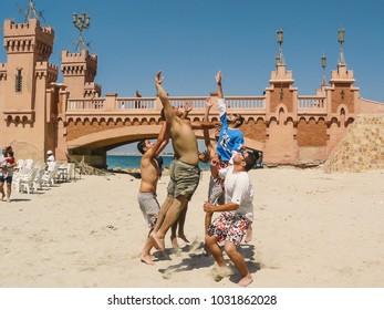 Alexandria, Egypt - 2008 - Group of young men playing beach vollyball in Al Montaza , Alexandria, Egypt.