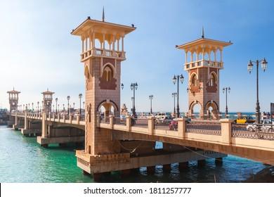 Alexandria, Egypt - December 14, 2018: People walk the Stanley Bridge, popular landmark of Alexandria, Egypt