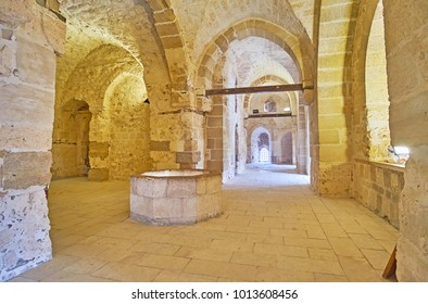 ALEXANDRIA, EGYPT - DECEMBER 17, 2017:  The walk along the narrow corridors of Qaitbay Castle with tall stone vaults and multiple chambers, on December 17 in Alexandria.