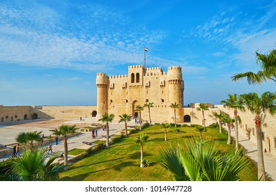 ALEXANDRIA, EGYPT - DECEMBER 17, 2017:  The scenic palm garden in front of Qaitbay citadel, the medieval pearl of the city, on December 17 in Alexandria.