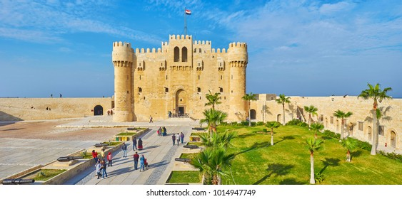 ALEXANDRIA, EGYPT - DECEMBER 17, 2017:  Panorama of Qaitbay citadel and its palm garden from the tall outer wall, on December 17 in Alexandria.