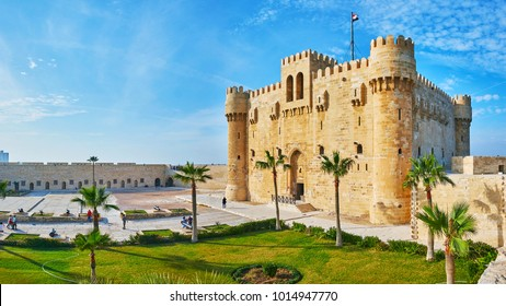 ALEXANDRIA, EGYPT - DECEMBER 17, 2017:  Panorama of Qaitbay citadel's courtyard with garden, castle and parade ground, surrounded by massive walls, on December 17 in Alexandria.