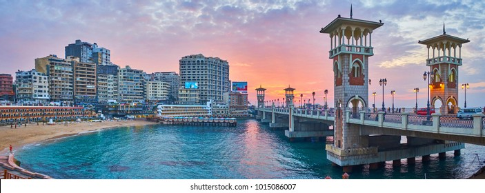 ALEXANDRIA, EGYPT - DECEMBER 17, 2017: Panorama of Stanley beach with a view on scenic bridge with towers during the sunset, on December 17 in Alexandria.