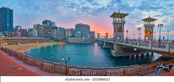 ALEXANDRIA, EGYPT - DECEMBER 17, 2017: Evening walk around Stanley beach, that becomes romantic place on sunset, Stanley bridge attracts tourists with nice viewpoints, on December 17 in Alexandria.