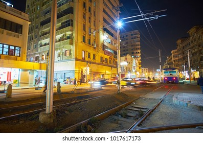 ALEXANDRIA, EGYPT - DECEMBER 17, 2017: The evening view of Mahta Al Raml square with riding vintage blue tram, on December 17 in Alexandria.