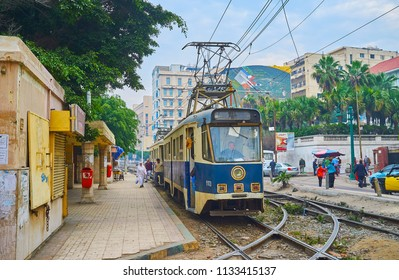 ALEXANDRIA, EGYPT - DECEMBER 18, 2017: Vintage Al Ramlh trams are nice attraction for tourists, different retro tram cars, available to explore central neighborhoods, on December  18 in Alexandria.