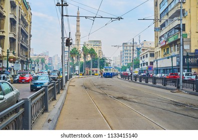 ALEXANDRIA, EGYPT - DECEMBER 18, 2017: Historical Mahta Al Raml square is place of tourist interest with old edifices, Al Qaed Ibrahim Mosque and riding retro trams, on December 18 in Alexandria.