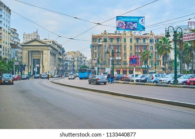 ALEXANDRIA, EGYPT - DECEMBER 18, 2017:  The wide street of Omar Lotfy with a view on historical mansions and Greek styled edifice of Chamber of Commerce, on December 18 in Alexandria.