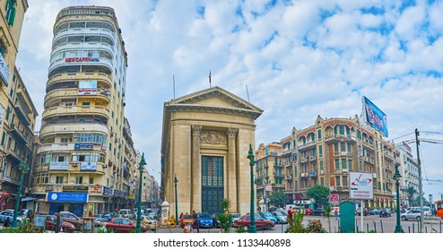 ALEXANDRIA, EGYPT - DECEMBER 18, 2017:  Diversity of architecture - Greek building of Chamber of Commerce neighbors with ordinary high-rise and mansions in Venetian style, on December 18 in Alexandria