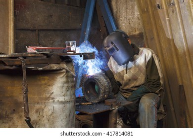 Alexandria, Egypt - March 25 ,2016: Young man welding.