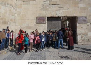 Alexandria / Egypt - March 8, 2019: Egyptian school children wait to enter the Qaitbay Citadel, established by Sultan Qaitbay in 1477 AD on Pharos Island.
