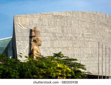 ALEXANDRIA, EGYPT - NOVEMBER 20, 2016: Facade of Alexandria Library in Egypt with ancient egyptian sculpture of Greek King Ptolemy II Philadelphus.