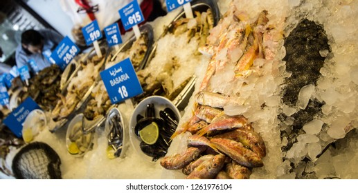 Alexandria, Egypt – November 6, 2018: photo for Fish shop in Alexandria city in Egypt, and showing some fish types and its price.