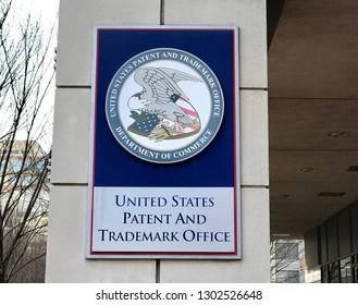 ALEXANDRIA, VA - FEBRUARY 2, 2019: US PATENT AND TRADEMARK OFFICE - Sign seal emblem at headquarters building.