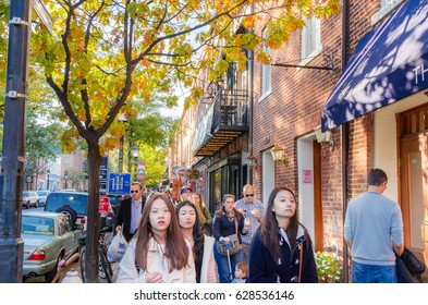 Alexandria, VA - October 23, 2016: People walking along a Pavement in Historic Old Town. With its concentration of boutiques, restaurants, and shops, Old Town is a major draw for locals and visitors.