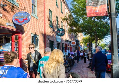 Alexandria, Va - October 23, 2016: Crowed Sidewalk along King Street on a Sunny Autumn Day. King Street, a walkable mile in Old Town, features more than 160 independent retailers.