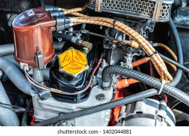 """ALEXANDRIA, VIRGINIA / USA - 19 MAY 2019: Close up of an engine at the Old Town Festival of Speed and Style, featuring a variety of vintage cars. The cap reads, """"Abarth & Co.: Use only Shell."""""""