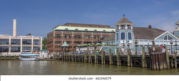 ALEXANDRIA, VIRGINIA, USA - JUNE 4, 2017: Old Town Alexandria, Potomac RIver waterfront. Torpedo Factory Art Center, left, and Chart House Restaurant, right.