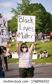 Alexandria, Virginia/USA- A Black Lives Matter protesters sign being held up up at a protest in Alexandria.