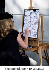 Alexandria, Virginia/USA-September 14, 2014: Caricature artist at Old Town Festival