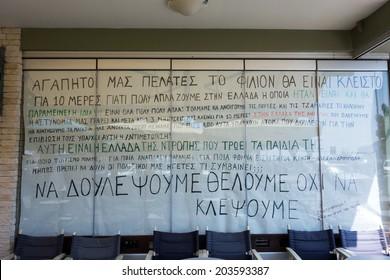 ALEXANDROUPOLIS, GREECE - JULY 4, 2014: Shop keeper's protest for the unfair shut-down of his business in Alexandroupolis town. He put up a big banner on his shop's window.