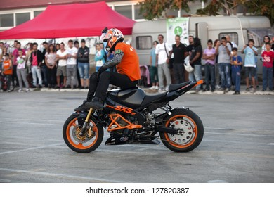 ALEXANDROUPOLIS, GREECE - OCTOBER 7: Motorcyclist in the Second Motor Beauty Contest Show, from the Stunt Xtreme Show Group performing extreme stand. October 7, 2012 in Alexandroupolis, Evros, Greece.