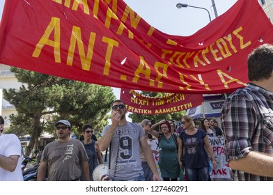 ALEXANDROUPOLIS, GREECE - SEPT 26: Protesters in city streets during protest rally against the greek government's new economic measures on September 26, 2012 in Alexandroupolis, Greece.