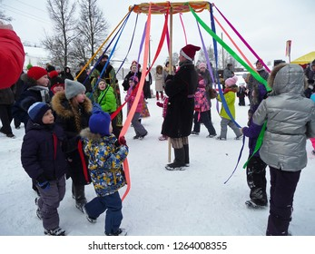 Alexandrov, Vladimir region, Russia - February 18, 2018  –  Children play traditional Russian games at the Maslenitsa festival in Alexandrovskaya Sloboda