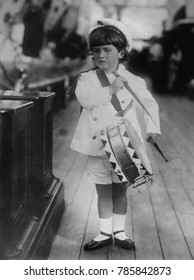 Alexei, the only son of Czar Nicholas II and his consort, Alexandra, 1909. The five year old Czarevich wears a sailors hat and plays a toy drum
