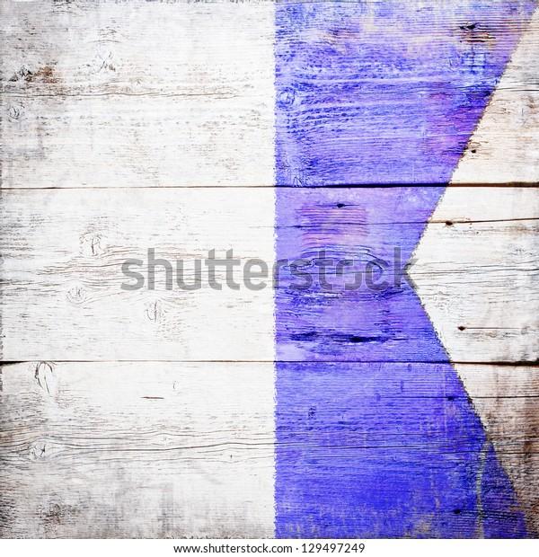 Alfa, international maritime signal flag painted on grungy wood plank background