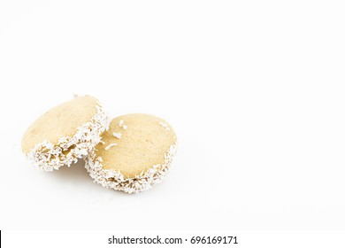 Alfajor of cornstarch, dulce de leche and grated coconut.