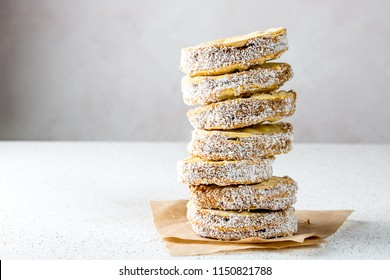 ALFAJORES. Latin American Peruvian Chilean Argentine Peruvian sweet Alfajores cookies whith manjar and coconut on white background.