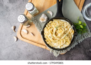 Alfredo pasta dinner with creamy white sauce and herbs