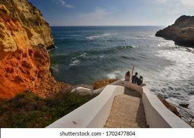 Algarve coast, Portimao town. Youth on the stairs