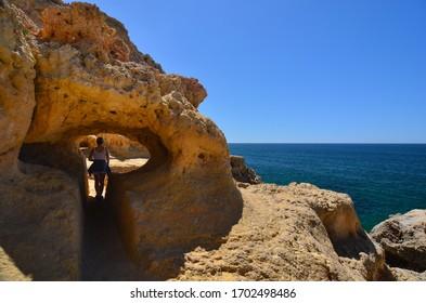 Algarve coast, rock formations and woman
