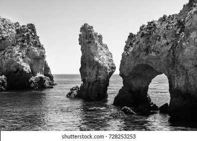 Algarve coastline in Portugal. Rocks and Sea in Lagos, Algrave, Portugal. Black and white