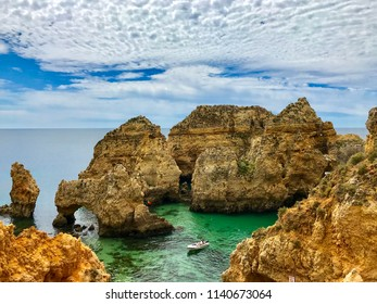 Algarve landscape with yellow rocks, sky and Atlantic ocean. Portugal Atlantic coast with turquoise watercolor.