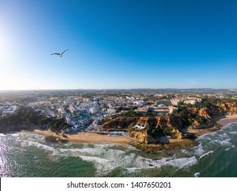 Algarve, Portugal aerial view on beach and coast of Atlantic Ocean. Hotels zone on Cliffs in Praia de Falesia Albufeira