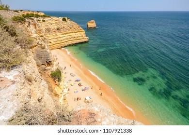 Algarve Portugal: Huge rocks at the cliff beach Praia da Marinha, lovely hidden beach near Lagoa