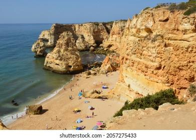 Algarve, Portugal - June 15, 2021: Tourists at the Marinha Beach