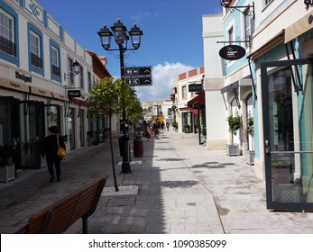 Algarve, Portugal - March 24, 2018: Shopping street in Algarve shopping center village near Loulé, Portugal. Horizontal view. Commercial and fashion