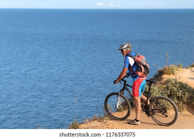 ALGARVE, PORTUGAL - MAY 29, 2018: Tourist enjoys mountain biking adventure in Algarve region, Portugal. Coastal region of Algarve attracts more than 17 million tourists annually.