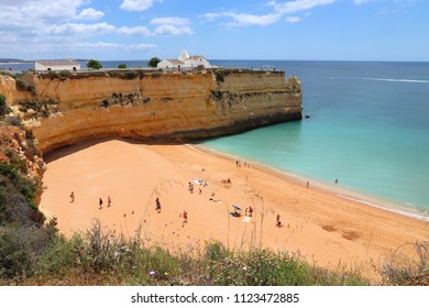Algarve, Portugal - Senhora da Rocha Beach with white chapel. Lagoa municipality.