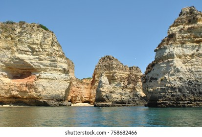 Algarve, southern Portugal. The most beautiful beaches in Europe. Orange Cliffs, caves and turquoise water. Atlantic Ocean .