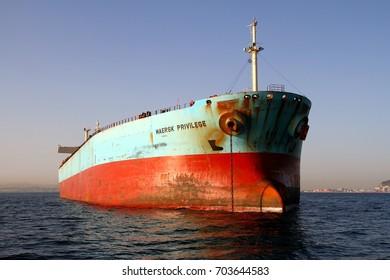 ALGECIRAS, SPAIN. AUGUST 04: The bulk-carrier MAERSK PRIVILEGE waits anchored for entering in the port of Algeciras, Spain; on august 04, 2017 in Cadiz.
