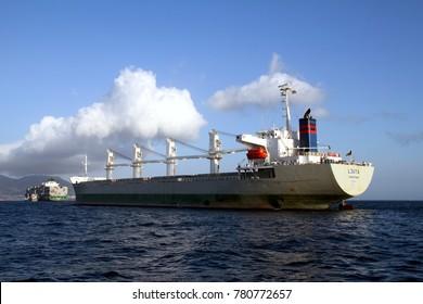 ALGECIRAS, SPAIN. AUGUST 04: The bulk-carrier LJUTA waits anchored for entering in the port of Algeciras, Spain; on august 04, 2017 in Cadiz.