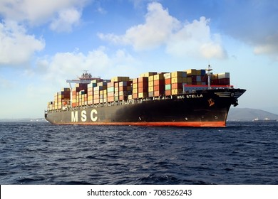 ALGECIRAS, SPAIN – AUGUST 15. The container ship MSC STELLA sailing in open waters after leave the port of Algeciras, on august 15, 2017 in Cadiz.
