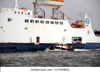 ALGECIRAS, SPAIN - AUGUST 23: The pilot cutter of Algeciras harbor sailing for help ferry Amman to leave the port, on august 23, 2018 in Algeciras.